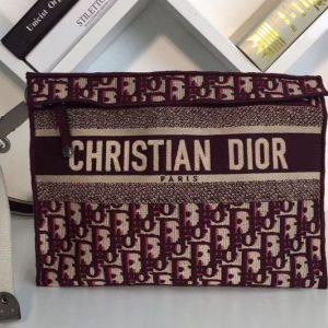 Replica Dior M1292 Clutch bag in burgundy Dior Oblique embroidered canvas