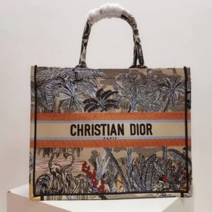 Replica Dior M1286 Book Tote 42mm bag in embroidered canvas With a denim blue Toile de Jouy Tropicalia motif