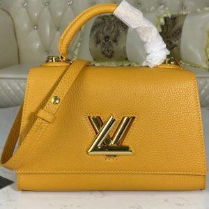 Replica Louis Vuitton M57136 LV Twist One Handle PM handbag in Saffron Taurillon leather